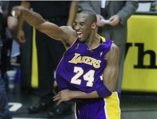 Kobe gets his Shaq-less ring (and copies MJ's celebration)