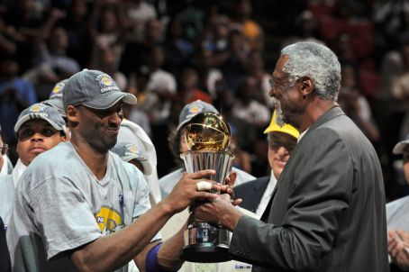 Kobe Accepts the Finals MVP Trophy from Bill Russell (Photo by Garrett Ellwood/NBAE via Getty Images)